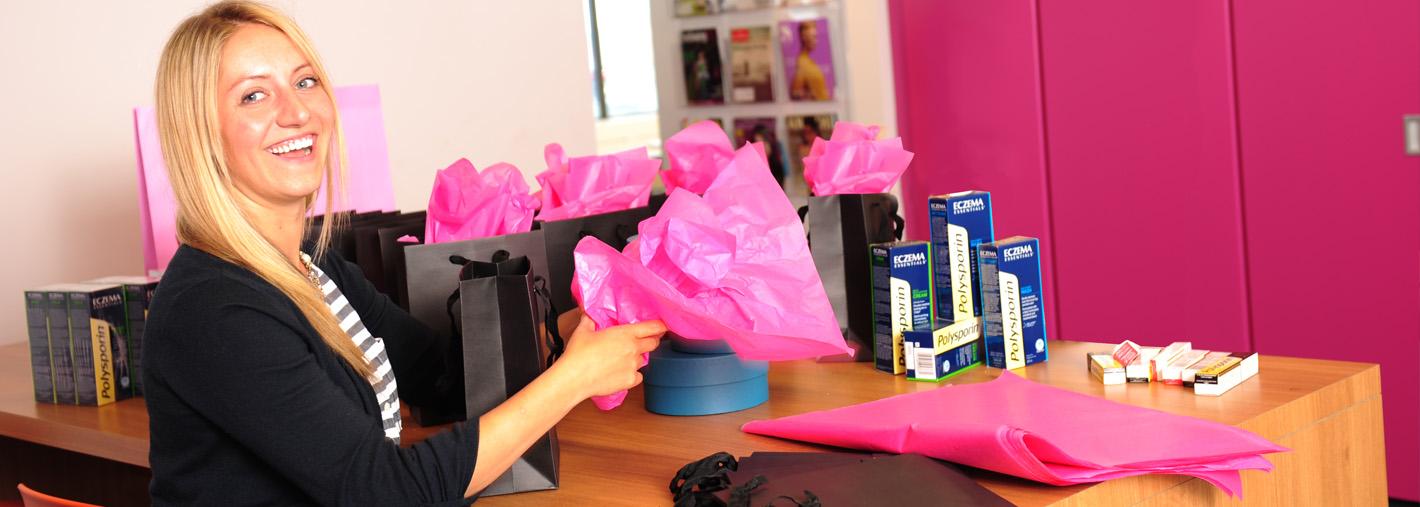 APEX staffer preparing media packages