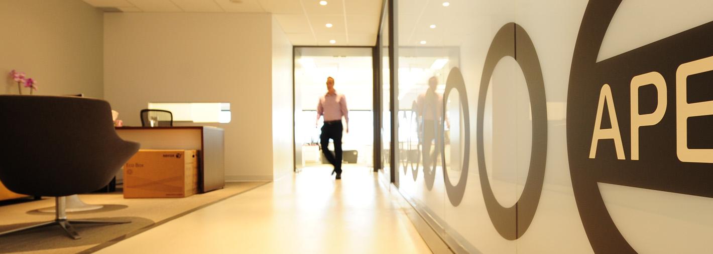 Individual walking in APEX lobby
