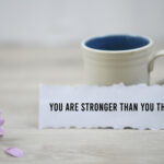 You are stronger than you think, a paper note with morning coffee.