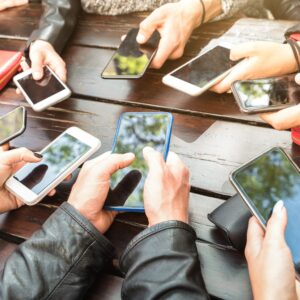 Teenager people having fun using smartphones – Millenial community sharing content on social media network with mobile smart phones – Technology concept with millennial playing with cellphone devices